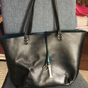 Black tote bag with teal interior!